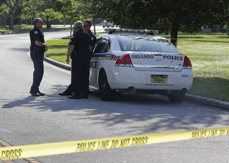 Police officers block the entrance to an apartment complex where man was fatally shot, Wednesday, May 22, 2013, in Orlando, Fla. The FBI says the man, being questioned by authorities in the Boston bombing probe, was fatally shot when he initiated a violent confrontation. (AP Photo/John Raoux)