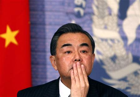 Chinese Foreign Minister Wang Yi attends a news conference in Kabul February 22, 2014. REUTERS/Mohammad Ismail