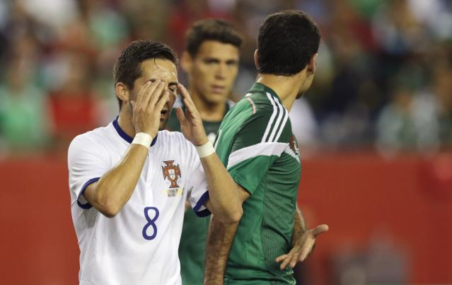 Portugal midfielder Joao Moutinho (8) reacts after missing a play in front of the net against Mexico during the first half of their friendly soccer match in Foxborough, Mass., Friday, June 6, 2014. (AP Photo/Charles Krupa)