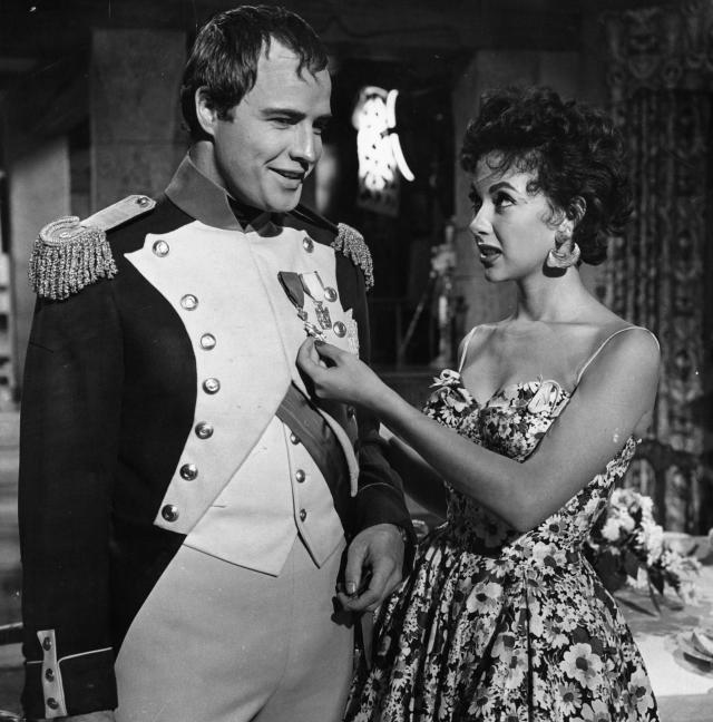 Marlon Brando and Rita Moreno visit on the set of the film <em>Désirée</em>, 1954. (Photo: Getty)