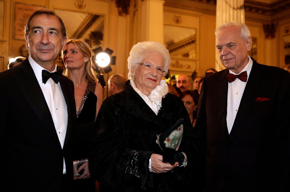 """Holocaust survivor Liliana Segre stands between La Scala general manager Alexander Pereira, right, and Milan Mayor Giuseppe Sala, left, as she arrives for the gala premiere of La Scala opera house, in Milan, Italy, Saturday, Dec. 7, 2019. Milan's storied La Scala opens its 2019-2020 season on Saturday with Puccini's """"Tosca,"""" which stars Russian soprano Anna Netrebko as the object of unwanted sexual attention from a powerful authority figure. (AP Photo/Luca Bruno) (Photo: ASSOCIATED PRESS)"""