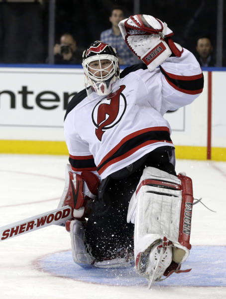 New Jersey Devils goalie Martin Brodeur makes a save during the second period of an NHL hockey game against the New York Rangers, Sunday, April 21, 2013, in New York. The Rangers defeated the Devils 4-1. (AP Photo/Seth Wenig)