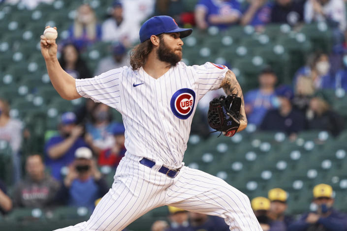 Chicago Cubs starting pitcher Trevor Williams (32) throws against the Milwaukee Brewers during the first inning of a baseball game, Monday, April, 5, 2021, in Chicago. (AP Photo/David Banks)