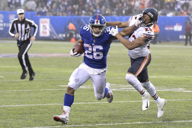 "<a class=""link rapid-noclick-resp"" href=""/nfl/players/30972/"" data-ylk=""slk:Saquon Barkley"">Saquon Barkley</a>'s fantasy owners are in good shape to stiff-arm the competition in the playoffs. (AP Photo/Bill Kostroun)"
