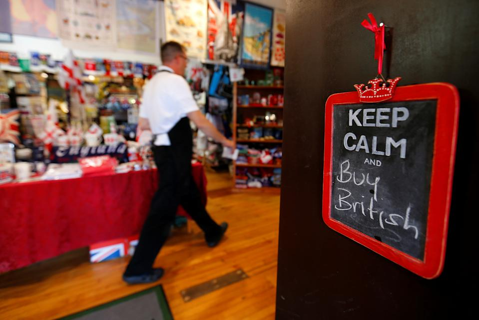 """A chalkboard sign informs visitors to """"Buy British"""" as they enter Shakespeare's Corner Shopppe, a store catering to all things British from food to tea pots, in San Diego, California, U.S. June 28, 2016.        REUTERS/Mike Blake"""