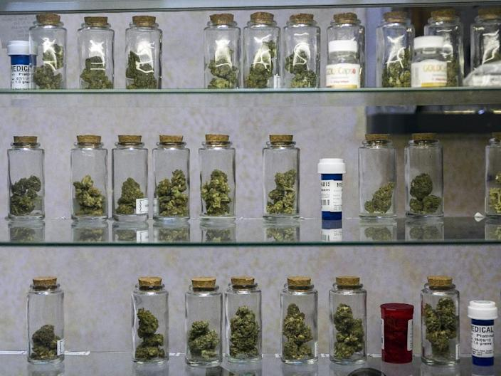 """FILE - This May 14, 2013 file photo shows medical marijuana vials displayed at the Venice Beach Care Center medical marijuana dispensary in Venice, Calif. It took 50 years for American attitudes about marijuana to zigzag from the paranoia of """"Reefer Madness"""" to the excesses of Woodstock back to the hard line of Just Say No. And now, in just a few short years, public opinion has shifted so dramatically toward pragmatic acceptance of marijuana that even those who champion legalization are surprised at how quickly attitudes are changing and states are moving to approve the drug for medical use and just for fun. (AP Photo/Damian Dovarganes)"""
