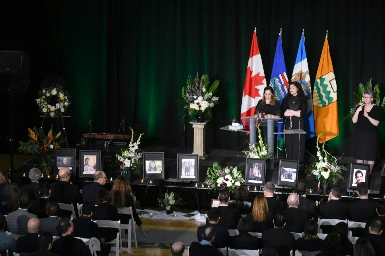 Mourners speak on stage during a memorial service for the victims of Ukrainian Airlines flight PS752 crash in Iran