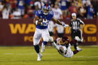 New York Giants running back Saquon Barkley (26) breaks away from Washington Football Team cornerback Bobby McCain (20) as he runs with the ball during the first half of an NFL football game, Thursday, Sept. 16, 2021, in Landover, Md. (AP Photo/Alex Brandon)