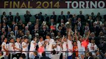 Sevilla's captain Ivan Rakitic holds the Europa League trophy aloft in 2014 as his teammates celebrate alongside him (Photo by John Walton - EMPICS/PA Images via Getty Images)