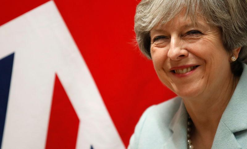 Britain's Prime Minister Theresa May attends a bilateral meeting during the Eastern Partnership summit at the European Council Headquarters in Brussels