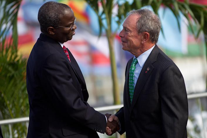 New York mayor Michael R. Bloomberg, right, and Babatunde Fashola of Lagos, shake hands during the UN Conference on Sustainable Development, or Rio+20, in Rio de Janeiro, Brazil, Tuesday, June 19, 2012. While squabbling between rich and poor countries threatens to derail the Earth summit, the world's mayors say they can't afford the luxury of endless, fruitless negotiations and are already taking real action to stave off environmental disaster and preserve natural resources for future generations. (AP Photo/Felipe Dana)