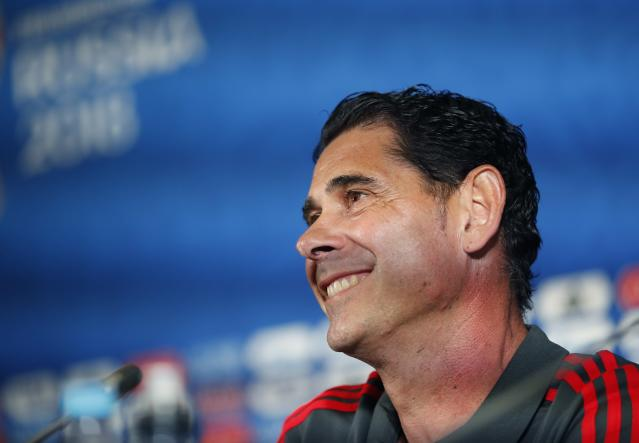 Spain head coach Fernando Hierro smiles during a press conference on the eve of the group B match between Iran and Spain at the 2018 soccer World Cup in the Fisht Stadium in Kazan, Russia, Tuesday, June 19, 2018. (AP Photo/Frank Augstein)