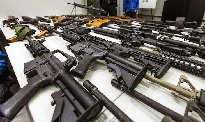 A variety of military-style semiautomatic rifles obtained during a buy back program are displayed at Los Angeles police headquarters on Thursday, Dec. 27,2012. Similar weapons have been used in at least four high-profile shootings in the past year, including most recently the Connecticut school shootings and the Christmas Eve killings of two New York firefighters. (AP Photo/Damian Dovarganes)