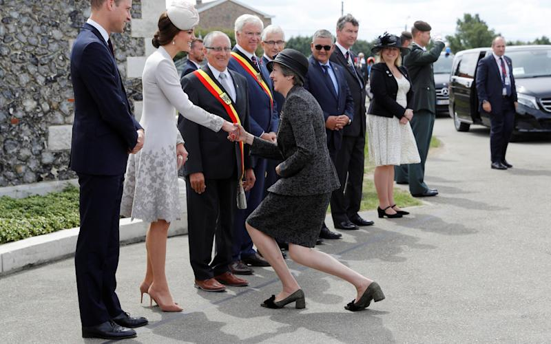 Theresa stooping so low it's a wonder her knees didn't dislocate - Getty Images Europe