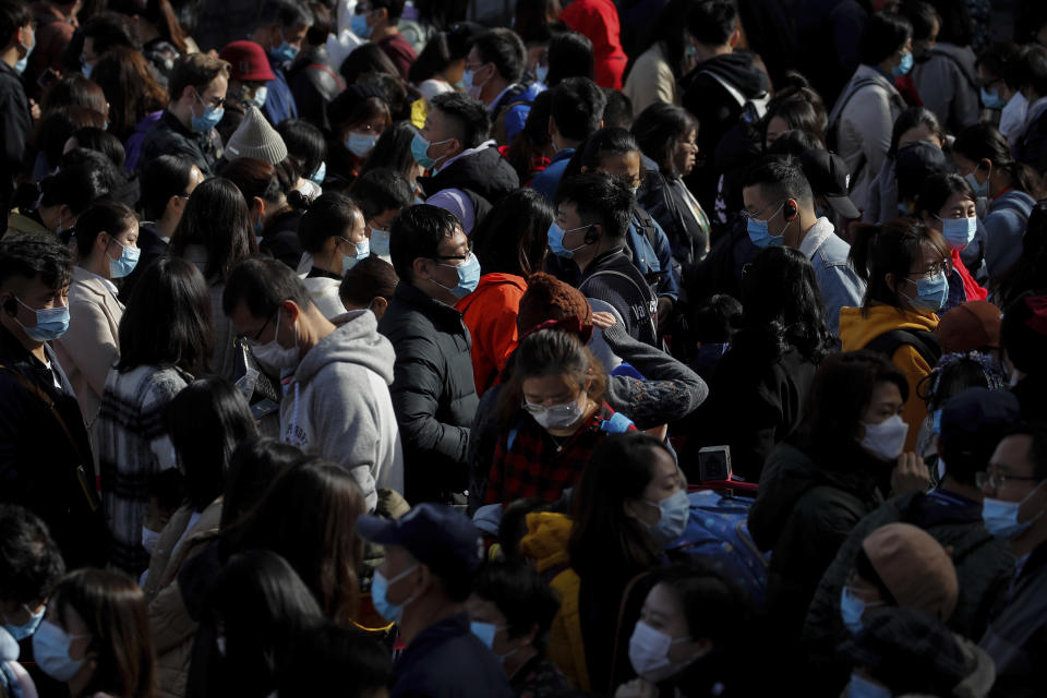 Visitors wearing face masks to help curb the spread of the coronavirus line up to enter an exhibition held at the Forbidden City in Beijing, Saturday, Nov. 7, 2020. China on Saturday reported 33 new confirmed coronavirus infections, all of which the National Health Commission said were in patients who contracted the virus abroad. (AP Photo/Andy Wong)