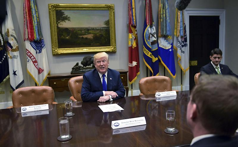 President Donald Trump, center speaks in the Roosevelt Room of the White House in Washington (AP Photo/Susan Walsh)