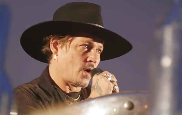 Johnny let fly on the US President during a talk at Glastonbury. Source: NME/YouTube
