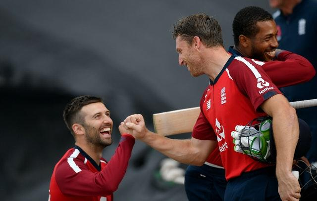 Jos Buttler, right, is congratulated by Mark Wood after guiding England to victory over Australia in the second Twenty20 international at the Ageas Bowl