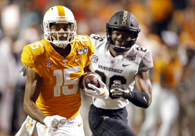 Tennessee wide receiver Jauan Jennings (15) outruns Vanderbilt safety Anfernee Orji (26) in the second half of an NCAA college football game Saturday, Nov. 30, 2019, in Knoxville, Tenn. (AP Photo/Wade Payne)