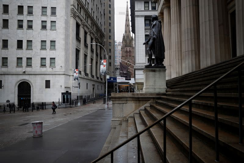 Nearly deserted Wall Street and steps of Federal Hall in lower Manhattan during outbreak of coronavirus disease (COVID-19) in New York