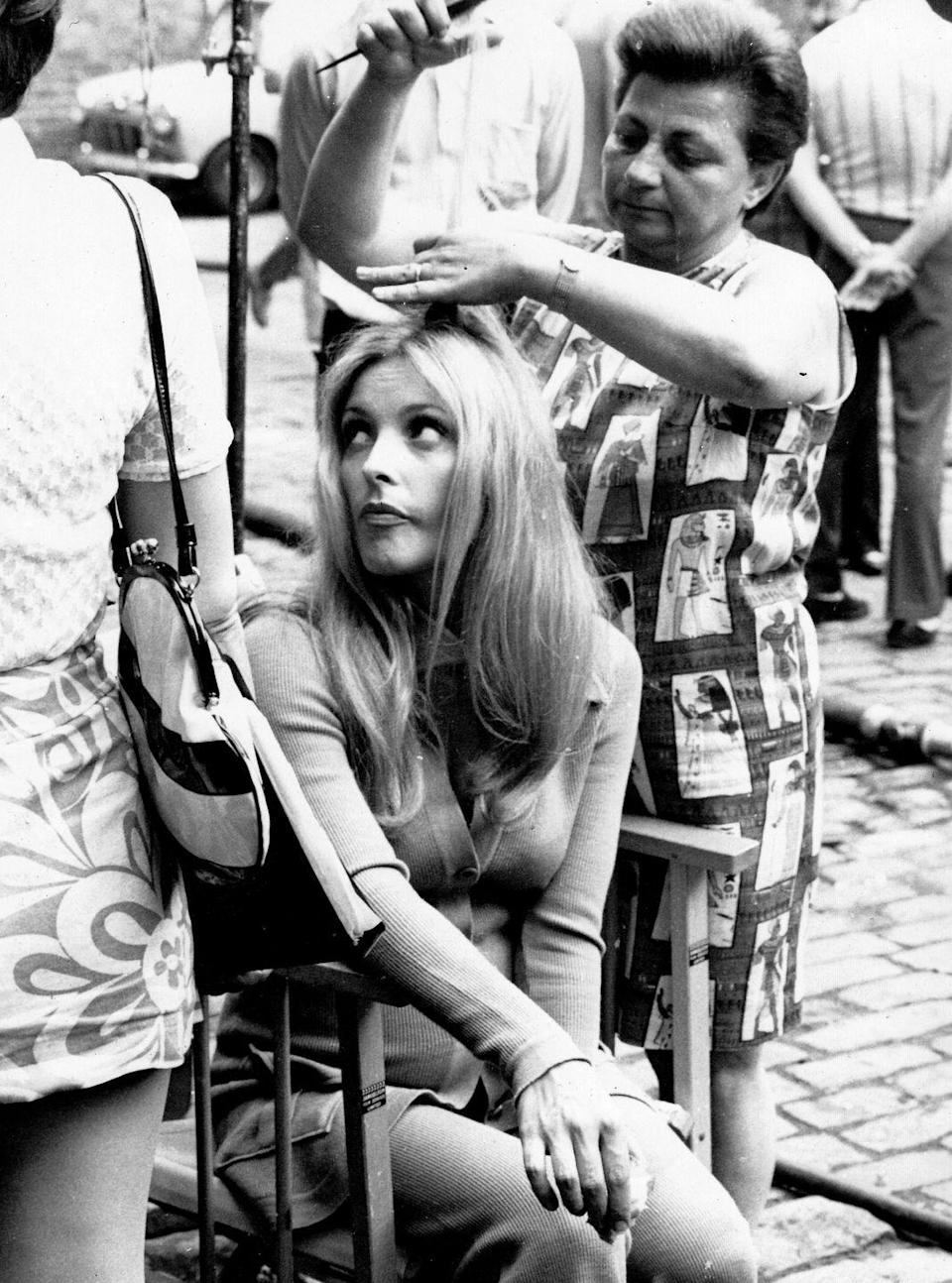 <p>A pregnant Sharon Tate is photographed in hair and makeup while filming her final film <em>12 + 1.</em></p>