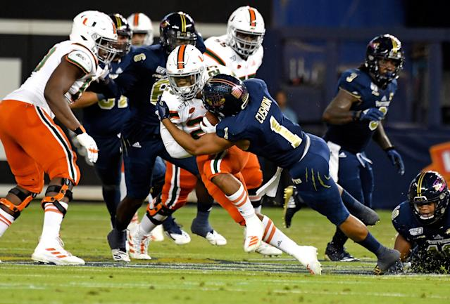 Miami Hurricanes running back Cam'Ron Harris (23) is tackled by FIU Golden Panthers defensive back Olin Cushion (1) during the first half. (USA Today)