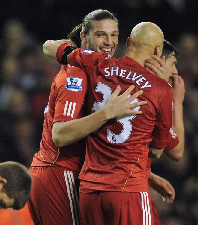 """Liverpool's English forward Andy Carroll (L) celebrates with his teammate English midfielder Jonjo Shelvey (R) after scoring during the FA Cup football match between Liverpool and Oldham Athletic at Anfield in Liverpool, north-west England, on January 6 2012. Liverpool won the match 5-1.  AFP PHOTO / ANDREW YATES RESTRICTED TO EDITORIAL USE. No use with unauthorized audio, video, data, fixture lists, club/league logos or """"live"""" services. Online in-match use limited to 45 images, no video emulation. No use in betting, games or single club/league/player publications"""