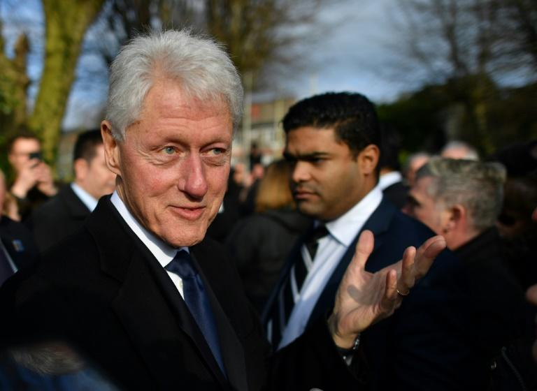 Former US President Bill Clinton speaks to mourners after the funeral of former Northern Ireland Deputy First Minister Martin McGuinness at St Columba's Church Long Tower, in Derry, Northern Ireland on March 23, 2017