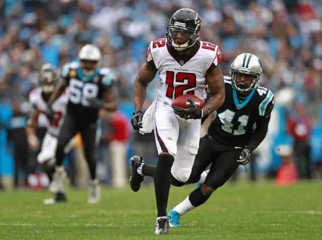 Atlanta Falcons' Mohamed Sanu (12) runs past Carolina Panthers' Captain Munnerlyn (41) for a touchdown during the second half of an NFL football game in Charlotte, N.C., Sunday, Dec. 23, 2018. (AP Photo/Jason E. Miczek)
