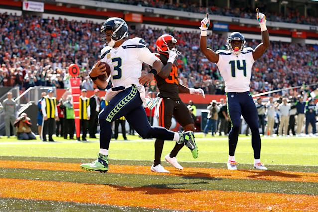 Russell Wilson scores a touchdown against the Cleveland Browns. (Getty Images)