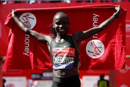 Athletics - London Marathon - London, Britain - April 22, 2018 Kenya's Vivian Cheruiyot celebrates after winning the Women's elite race REUTERS/Paul Childs