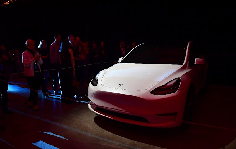 People view the new Tesla Model Y unveiled in Hawthorne, California