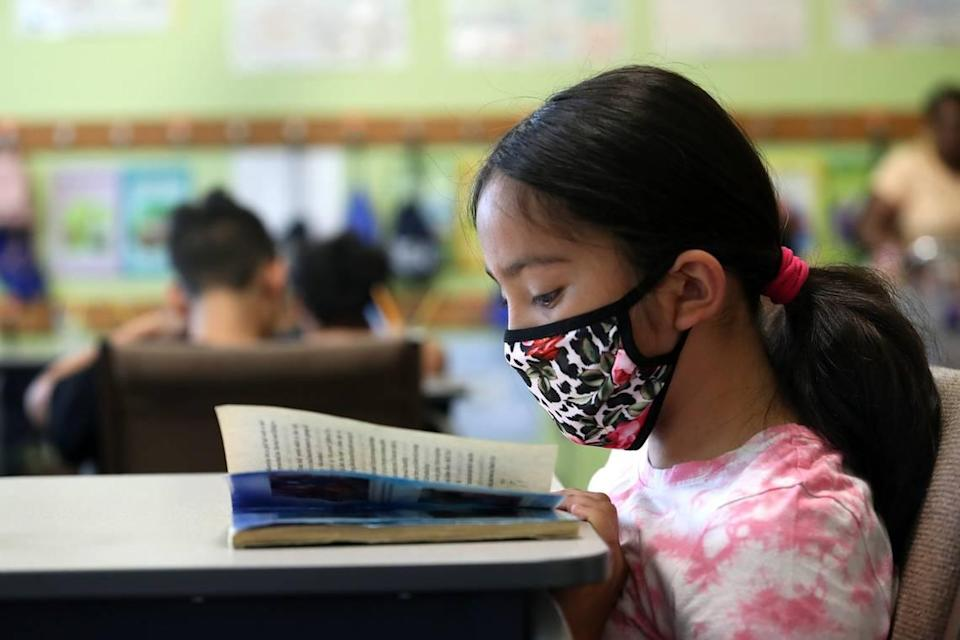 """Maryjane Angel reads during a summer program to fight the """"COVID slide"""" for young students at the United Community Centers (UCC) Polytechnic Center on Tuesday, July 13, 2021, in Fort Worth."""