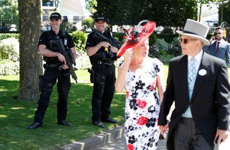 Horse Racing - Royal Ascot - Ascot Racecourse, Ascot, Britain - June 21, 2018 Armed police look on as racegoers arrive before the start Action Images via Reuters/Paul Childs