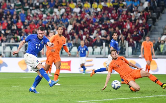 Italy's Andrea Belotti, left, shoots at the goal during the friendly soccer match between Italy and The Netherlands at the Allianz Stadium in Turin, Italy, Monday, June 4, 2018 (Alessandro Di Marco/ANSA via AP)