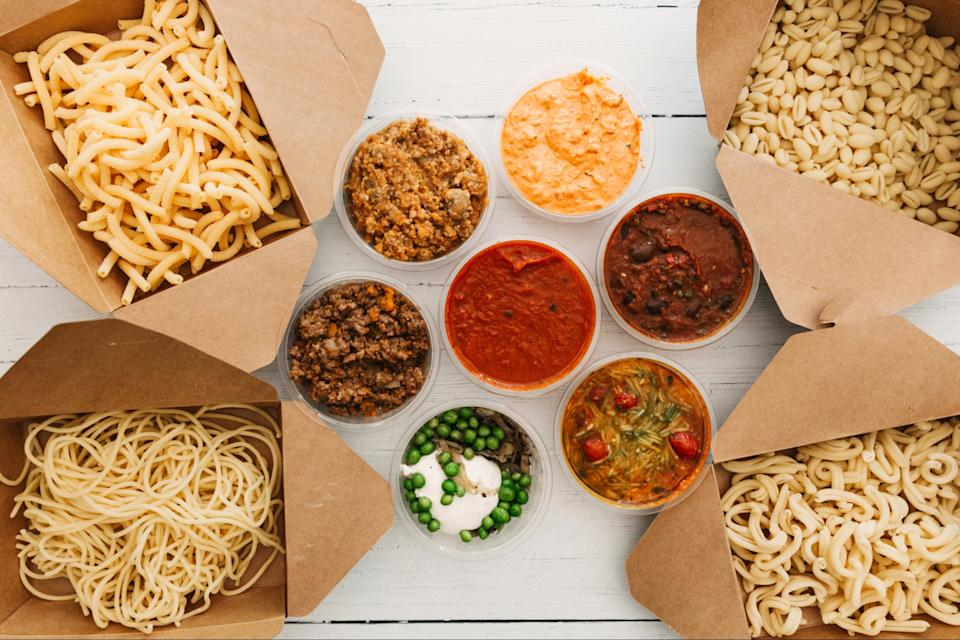 <p>Stylishly presented: Artusi's attractively put together box is full of pasta and neatly labelled sauce pots</p> (Sam Harris)