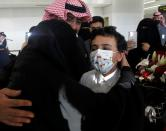 Woman hugs her relative who arrived from Doha, at King Khalid International Airport in Riyadh