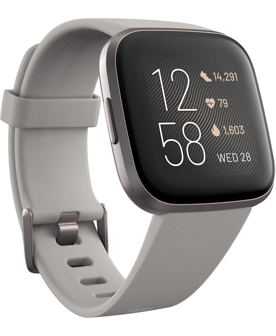 """<p><strong>Fitbit</strong></p><p>macys.com</p><p><strong>$199.95</strong></p><p><a href=""""https://go.redirectingat.com?id=74968X1596630&url=https%3A%2F%2Fwww.macys.com%2Fshop%2Fproduct%2Ffitbit-versa-2-mist-gray-elastomer-strap-touchscreen-smart-watch-39mm%3FID%3D10130330&sref=https%3A%2F%2Fwww.cosmopolitan.com%2Fhealth-fitness%2Fg28172667%2Fbest-fitbit-for-women%2F"""" rel=""""nofollow noopener"""" target=""""_blank"""" data-ylk=""""slk:Shop Now"""" class=""""link rapid-noclick-resp"""">Shop Now</a></p><p>Tell the Versa 2 you're going for a run (or doing yoga or hitting the weight room) to record your fave workouts and keep an eye on your heart rate as you sweat. If you just want someone to tell you what to do, tap one of the pre-programmed workouts and follow along as the Fitbit Coach demos each move.</p>"""