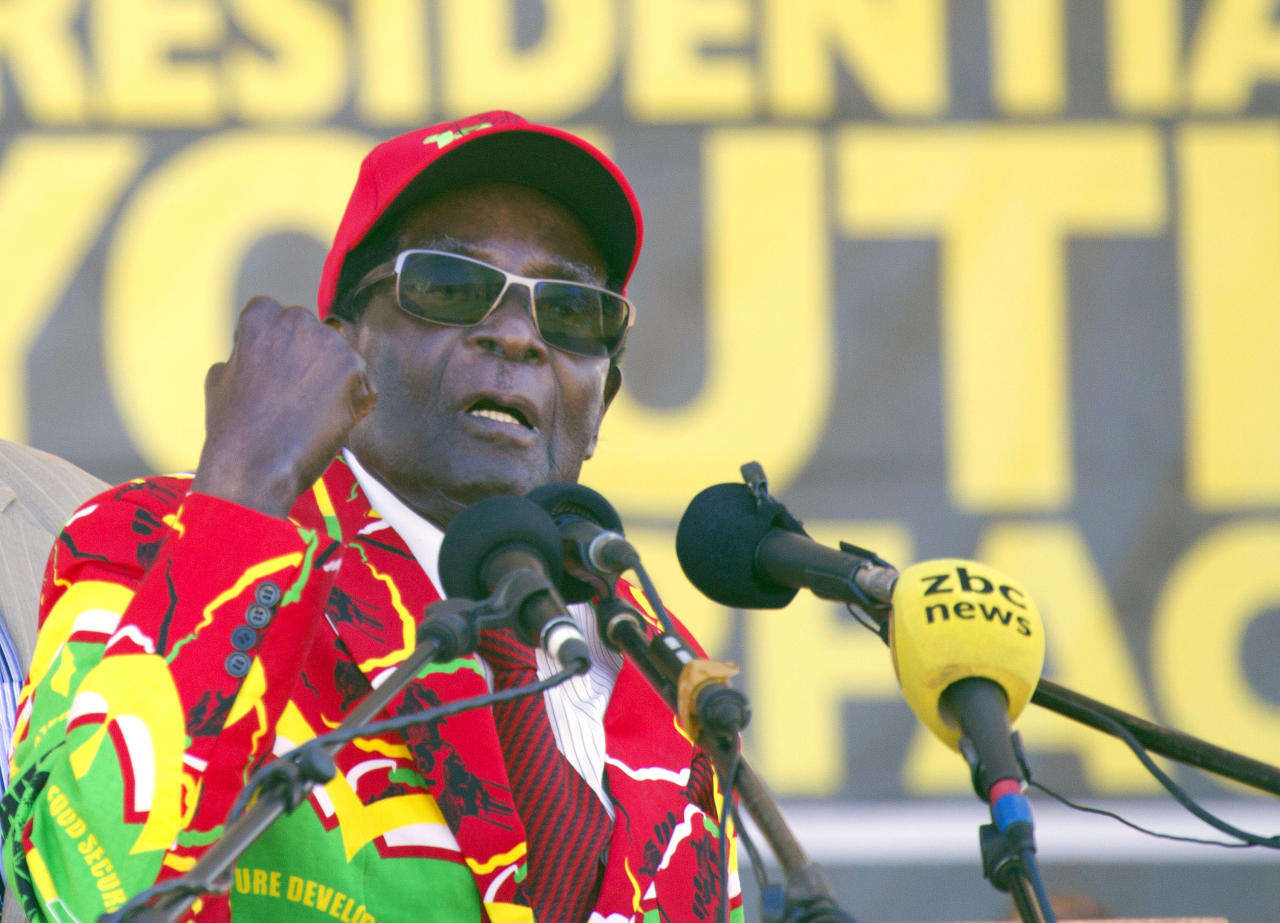 Zimbabwe's President Robert Mugabe greets supporters at a rally in Lupane about 170 Kilometres north of Bulawayo, Zimbabwe, Friday, July 21, 2017. Mugabe's rally is his first since his return from a routine medical review in Singapore. The world's oldest leader has launched a series of rallies targeting the youth ahead of Presidential elections set for 2018. (AP Photo/Tsvangirayi Mukwazhi)