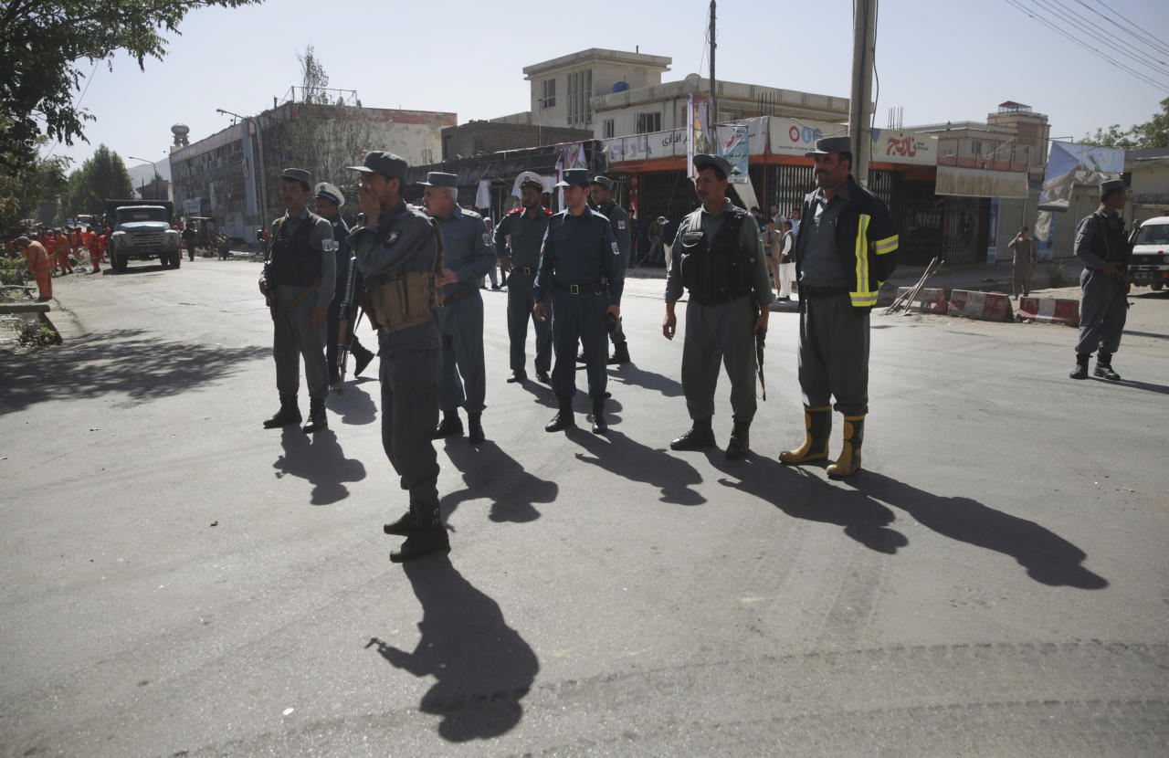 <p> Policemen stand guard at the site of a suicide attack in Kabul, Afghanistan, Monday, July 24, 2017. A suicide car bomb killed dozens of people as well as the bomber early Monday morning in a western neighborhood of Afghanistan's capital where several prominent politicians reside, a government official said. (AP Photos/Massoud Hossaini) </p>
