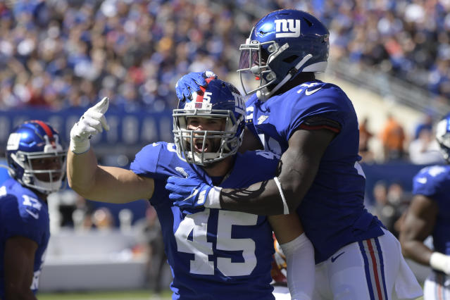 New York Giants' Nate Stupar, left, reacts after a stop during the first half of an NFL football game against the Washington Redskins, Sunday, Sept. 29, 2019, in East Rutherford, N.J. (AP Photo/Bill Kostroun)