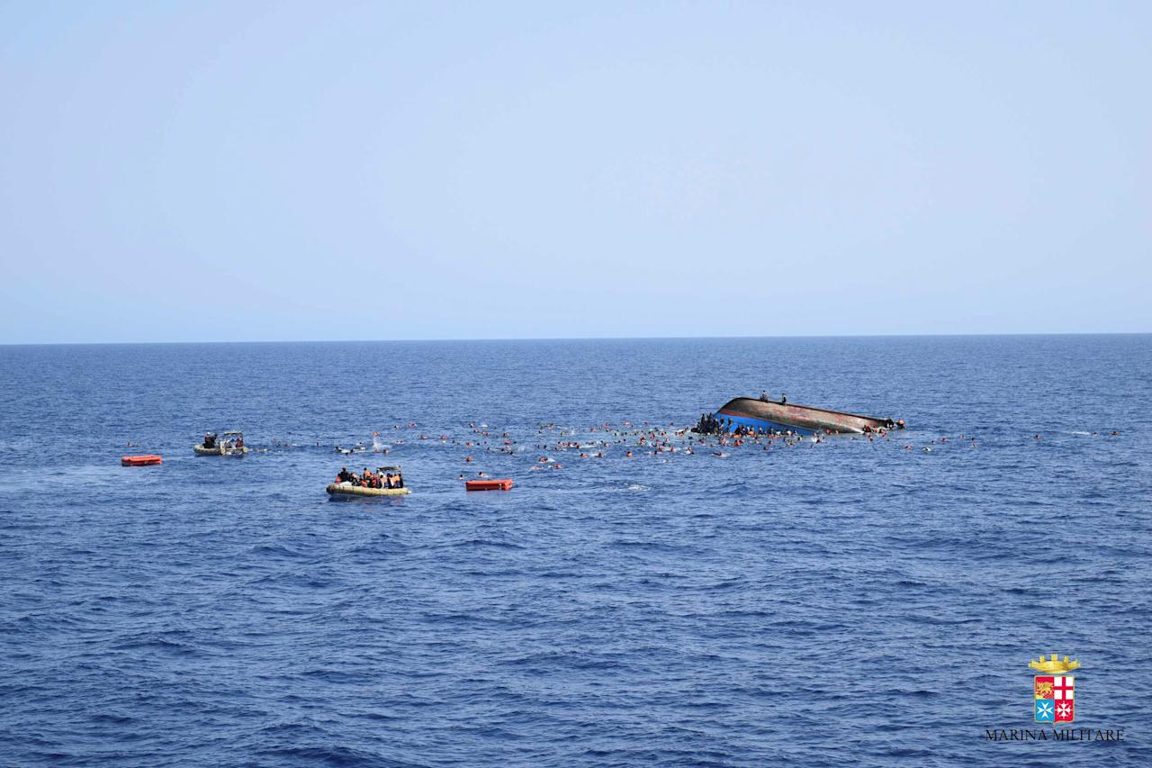 "Migrants are rescued from a capsized boat during a rescue operation by Italian navy ships ""Bettica"" and ""Bergamini"" off the coast of Libya in this handout picture released by the Italian Marina Militare on May 25, 2016. Marina Militare/Handout via REUTERS    ATTENTION EDITORS - THIS PICTURE WAS PROVIDED BY A THIRD PARTY. FOR EDITORIAL USE ONLY."