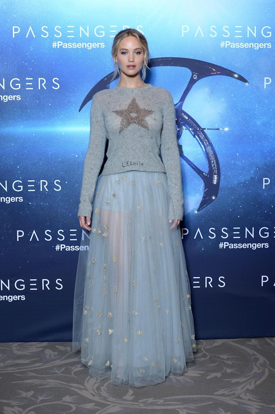 <p>OK, so we can't all afford a Dior ensemble like this one, but printed jumpers and semi-sheer skirts like Jennifer's are in practically every high street shop at the moment. [Photo: Getty] </p>