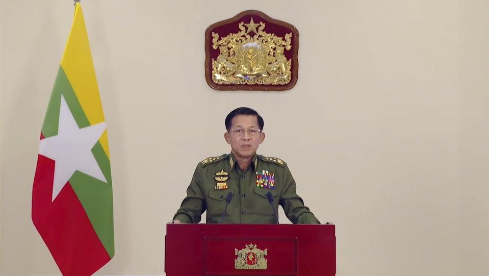 In this image taken from video posted in Tatmadaw True Information Team Facebook page, State Administrative Council Chairman and Commander-in-Chief Senior Gen. Min Aung Hlaing makes a televised statement Thursday, Feb. 11, 2021, in Naypyitaw, Myanmar. The hopes of building a robust democracy in Myanmar were shattered when the powerful military toppled the elected government of Aung San Suu Kyi and her National League for Democracy party in Feb. 1 coup. (Tatmadaw True Information Team Facebook page via AP)