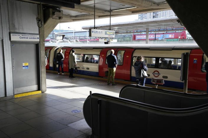 Commuters at Canning Town underground station after Boris Johnson said people who cannot work from home should be 'actively encouraged' to return to their jobs from Monday. (Aaron Chown/PA Images via Getty Images)
