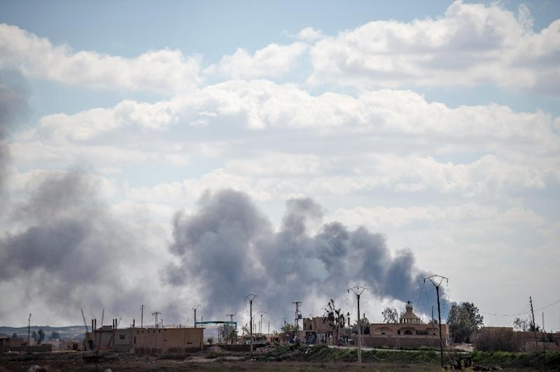 The Islamic State group's last sliver of territory in Syria is coming under heavy artillery fire and air strikes (AFP Photo/BULENT KILIC)