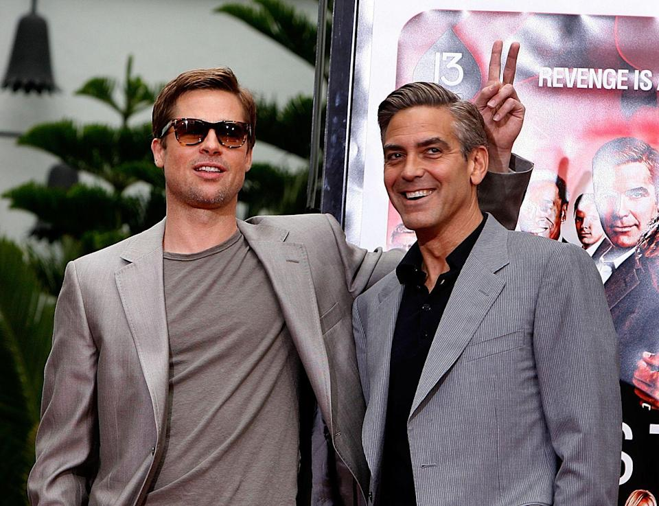 <p>Brad Pitt and Clooney pose for photos during their hand and footprints ceremony at Grauman's Chinese Theatre in Hollywood, California on June 5, 2007.</p>