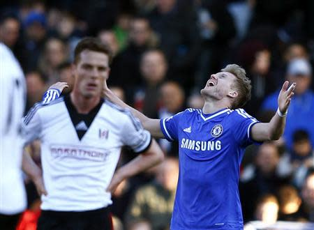 Chelsea's Andre Schurrle (R) celebrates after scoring a second goal as Fulham's Scott Parker (L) reacts during their English Premier League soccer match at Craven Cottage in London March 1, 2014. REUTERS/Eddie Keogh