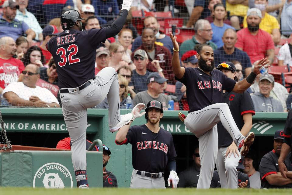 Cleveland Indians' Franmil Reyes (32) celebrates his solo home run during the third inning of a baseball game against the Boston Red Sox, Sunday, Sept. 5, 2021, in Boston. (AP Photo/Michael Dwyer)