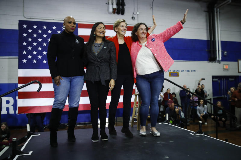 Democratic presidential candidate Sen. Elizabeth Warren, D-Mass., second right, is joined on stage by Rep. Ayanna Pressley, D-Mass., left, Rep. Deb Haaland, D-N.M., and Rep. Katie Porter, D-Calif., during a campaign event at Rundlett Middle School, Sunday, Feb. 9, 2020, in Concord, N.H. (AP Photo/Matt Rourke)